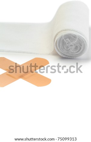 Band-aid and tensor bandage on a white background - stock photo