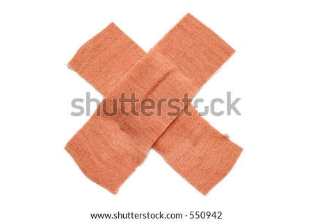Band aid type dressing arranged in the shape of an x isolated on a white background