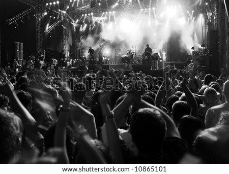 Band at a rock concert. Blur crowd - stock photo