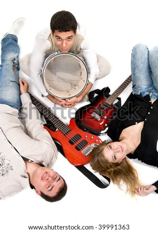 Band laying on floor with instruments - stock photo