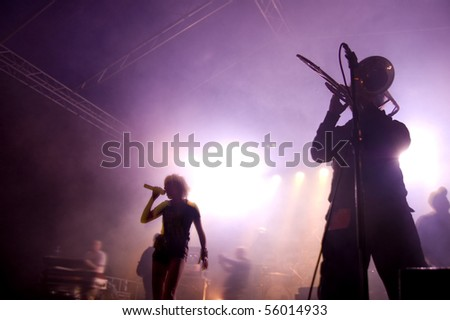Band on stage at concert. Band performing songs on stage. - stock photo