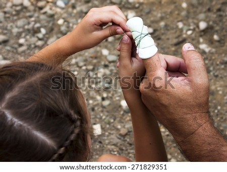 Bandaged finger. Girl binds damaged finger bandage from his grandfather. Girl helping grandfather in difficult times. aid for the wounded. How to bandage the finger. healthcare - stock photo