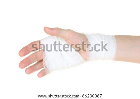 Bandaged hand isolated on white - stock photo