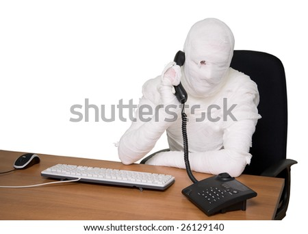 Bandaged man in office calling by telephone - stock photo
