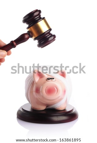 bandaged piggy bank with gavel on white background - stock photo