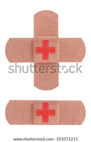 Bandaids or bandages with red cross isolated on white. - stock photo
