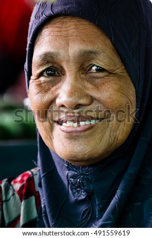BANDAR SERI BEGAWAN, BRUNEI May 23 2014 - Unidentified woman at riverside market