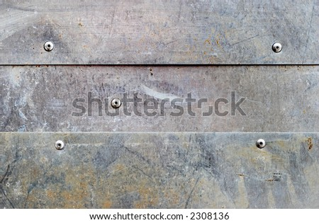 banded grunge dirty aluminium background with rivets