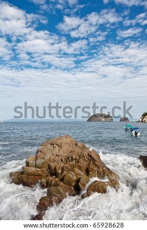 Banderas Bay and Los Arcos view from Mismaloya, near Puerto Vallarta, Mexico - stock photo