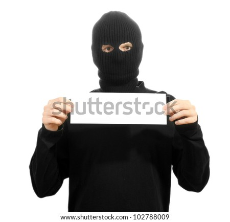 Bandit in black mask with blank card isolated on white - stock photo