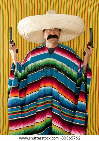 Bandit mustache Mexican gunman with revolver  sombrero and  poncho - stock photo