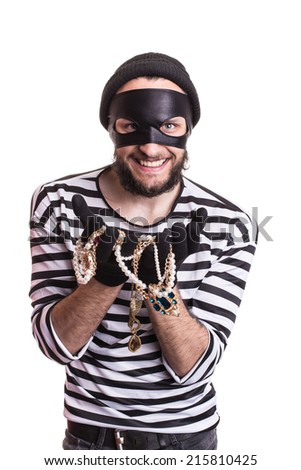 Bandit showing stolen jewelry and smiling. Portrait isolated on white background  - stock photo