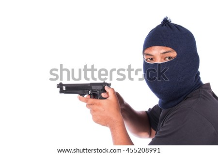 Bandit with gun in hand - stock photo