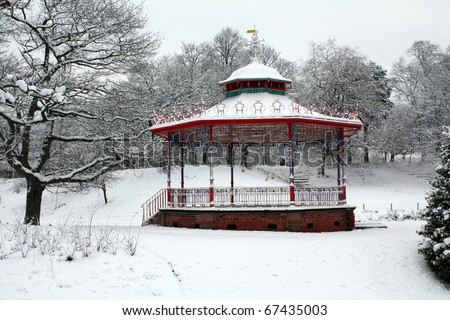 bandstand snow scene sefton park, liverpool, england - stock photo