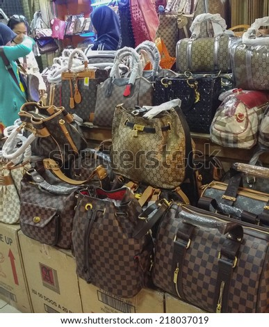 BANDUNG, WEST JAVA ISLAND, INDONESIA -SEPTEMBER 16, 2014: Large collection of famous fake handbags on display at one of the shopping centres in Bandung. The fake handbags are widely sold cheaply here.