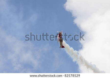 BANESTI, ROMANIA - AUGUST 6: Sukhoi Su-26 piloted by Jurgis Kairys from Lithuania during Banesti Airshow 2011 on August 6, 2011 in Banesti, Romania. - stock photo
