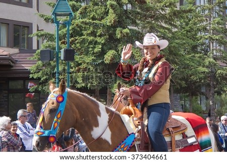 Banff, Alberta, Canada - July 1, 2012: Calgary Stampede Indian Princes waves at spectators at the Canada Day Parade in Banff, Alberta, on July 1st, 2012 in Banff.  - stock photo