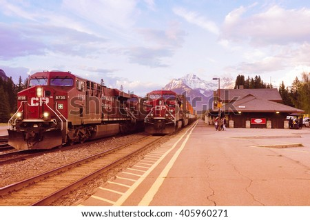 Banff, Canada, June 06, 2011: Freight trains from Vancouver and from Calgary meet each other in Banff at sunset time.