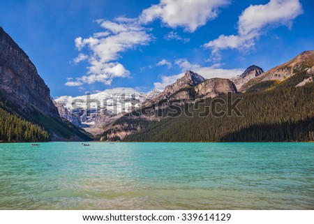 Banff National Park, Canada, Alberta. Magnificent Lake Louise with emerald water surrounded by the Rocky Mountains and glaciers - stock photo