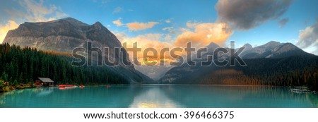 Banff national park Lake Louise sunrise panorama with mountains and forest in Canada. - stock photo