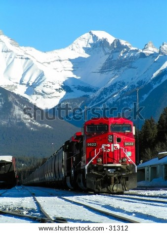 Banff trainstation. Rockies in the background. - stock photo