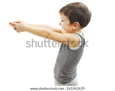 Bang bang. Boy pointing in the copy space with gun gesture. Isolated on white background  - stock photo