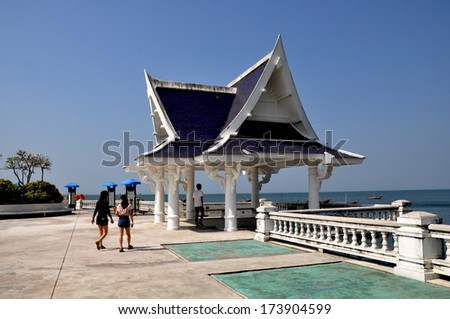 Bang Saen, Thailand January 10, 2014:  A charming white Thai sala overlooks the sea in Hat Won Public Park