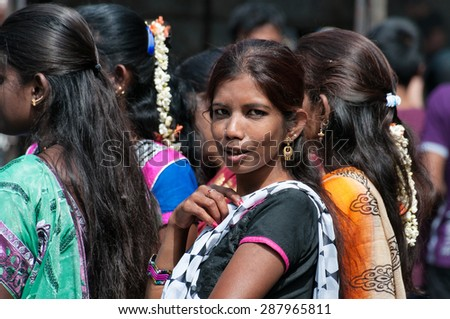 BANGALORE, INDIA - DEC 25, 2014:  Unidentified Indian women on Russell Market. Russell Market is a shopping market in Bangalore, built in 1927 by the British.  - stock photo