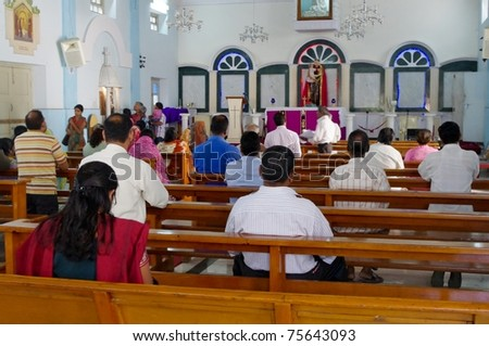 BANGALORE, INDIA - MARCH 22: Church congregation in St. Patrick's Church, March 22, 2011, Bangalore, India. Christianity is the 3rd largest religion in India with 25 million mainly Catholic followers.