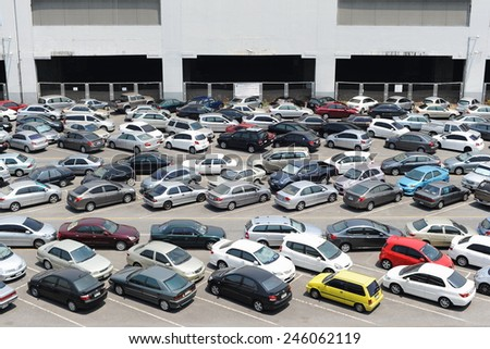 BANGKOK - Apr 5: Cars parked at a park and ride lot at a BTS station in Chatuchak district on Apr 5, 2014 in Bangkok, Thailand. The government has promoted park and ride to reduce traffic congestion. - stock photo