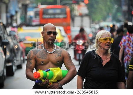 BANGKOK - APR 13: Revellers celebrate the traditional Thai New Year or Songkran near Khao San Road on Apr 13, 2014 in Bangkok, Thailand. The new year is marked with water fights and street parties. - stock photo