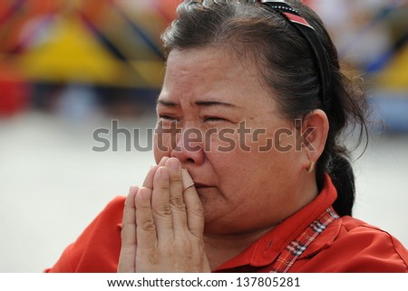 BANGKOK - APRIL 10: A red Shirt protesters joins a rally at Democracy Monument in remembrance of clashes that claimed 26 lives three years ago to the day on April 10, 2013 in Bangkok, Thailand. - stock photo