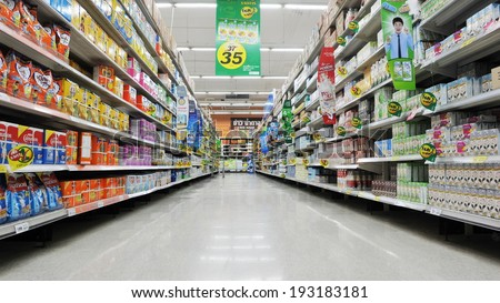 BANGKOK - APRIL 14: Aisle view of a Tesco supermarket on April 14, 2013 in Bangkok, Thailand. Tesco is the world's second largest retailer with 6,531 stores worldwide and a revenue of �£65bn in 2012. - stock photo