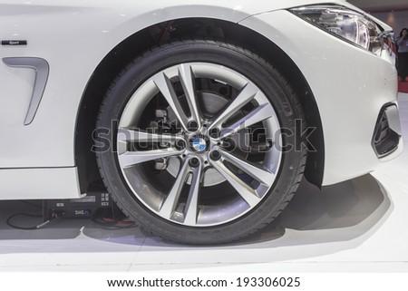 BANGKOK - APRIL 2: BMW wheel on display at The 35th Bangkok International Motor Show on April 2, 2014 in Bangkok, Thailand. - stock photo
