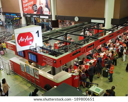 Bangkok - April 13: Check-in counter of AirAsia at Dong Mueang International Airport in Bangkok, Thailand on April 13, 2014. AirAsia is a pioneer of low-cost airline in Asia. - stock photo