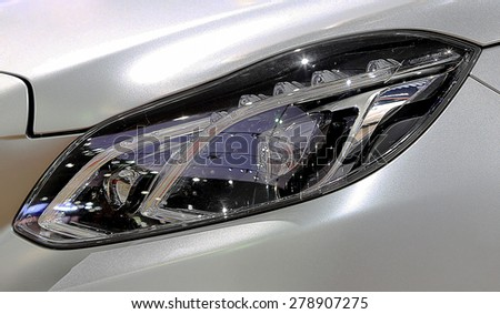 Bangkok - April 2 : close up headlights of Mercedes Benz series E300 estate blue TEC hybrid - in display at The 36th Bangkok international Motor Show 2015 on April 2, 2015 in Bangkok Thailand - stock photo