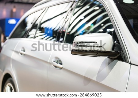 BANGKOK - APRIL 3 : Detail on the side mirror of benz E300 Estate blue tec hybrid in The 36 th Bangkok International Motorshow , on April. 3, 2015 in Bangkok, Thailand - stock photo