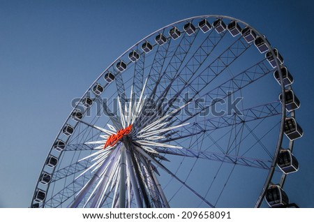 BANGKOK -  6 April : Ferris wheel in Asiatique The Riverfront, an expansive open-air mall with river views and  'festival market and living museum' concept. on April 6, 2014 in Bangkok, Thailand
