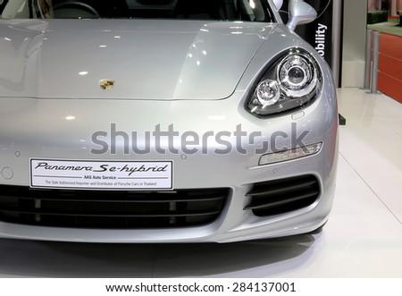 Bangkok - April 2 :headlight of Porsche series Panamera Se hybrid luxury sport car - in display at The 36th Bangkok international Motor Show 2015 on April 2, 2015 in Bangkok Thailand - stock photo