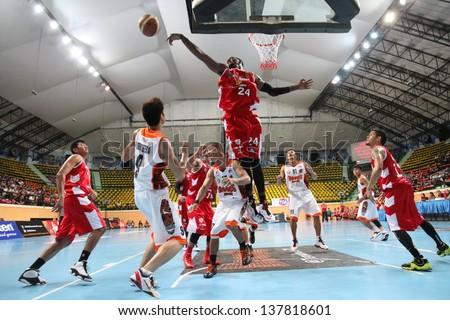 "BANGKOK - APRIL 24:Justin Williams #24 of San Miguel Beermen jump shot for block in an ASEAN Basketball League ""ABL"" at Nimitbut Stadium on April 24, 2013 in Bangkok,Thailand.SMB beat SRTS 78-70 - stock photo"