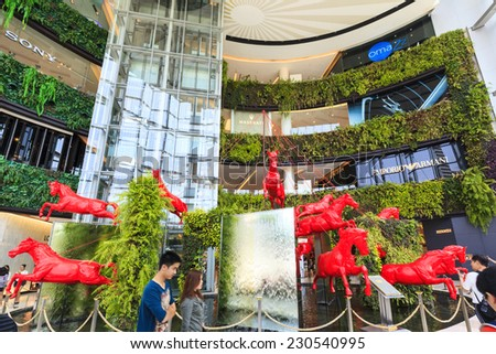 BANGKOK - APRIL 20 2014 : People shopping at Siam Paragon, it is a shopping mall in Bangkok, Thailand -  which one of the biggest shopping centre in Asia and ranking one of the largest in the world. - stock photo