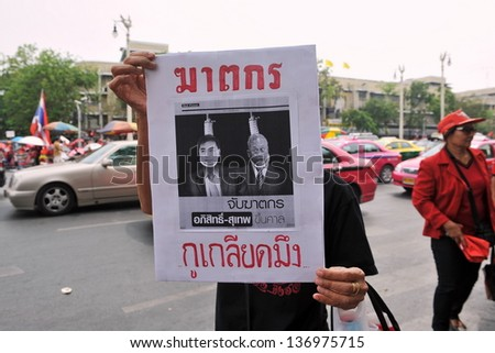 BANGKOK - APRIL 10: Red Shirt protesters rally at Democracy Monument in remembrance of violent clashes that claimed 26 lives three years ago to the day on April 10, 2013 in Bangkok, Thailand.