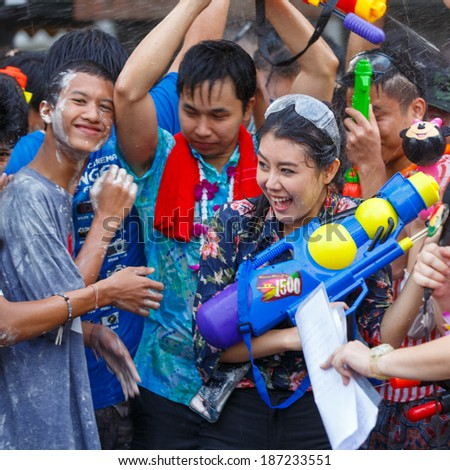 BANGKOK - APRIL 14: Revellers celebrate the Thai New Year near Khao San Road on April 14, 2014 in Bangkok, Thailand. The new year, or Songkran, is celebrated with street parties and water fights.