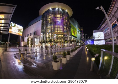 BANGKOK APRIL 28: Shoppers visit Siam Paragon mall in Siam Square mall on April 28, 2014 in Bangkok, Thailand. With 300,000 m2 of retail space Siam Paragon is one of the largest malls in the world.  - stock photo