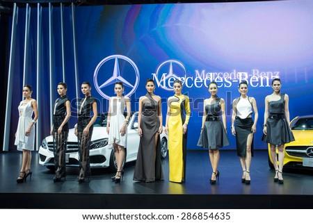 BANGKOK - April 5, 2015 : Unidentified model with Mercedes-Benz car on display at The 36th Bangkok International Motor show on March 24, 2015 in Bangkok, Thailand. - stock photo