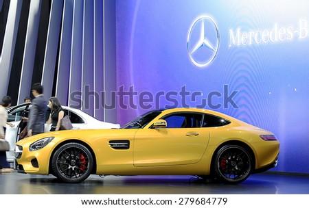 Bangkok - April 2 : yellow Mercedes Benz sport car in display at The 36th Bangkok international Motor Show 2015 on April 2, 2015 in Bangkok Thailand - stock photo