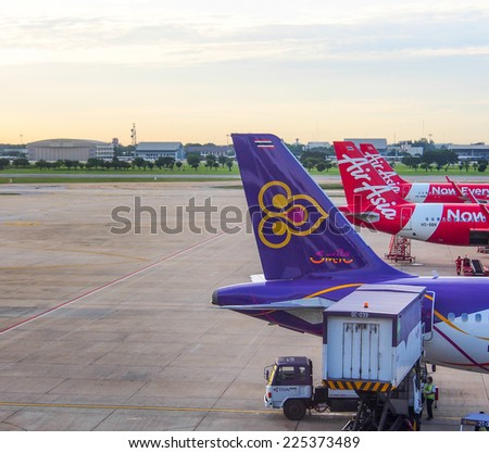 BANGKOK - AUG 11: Commercial aircraft wait for taking off at Don Muang international airport   on August 11, 2014 in Bangkok, Thailand. This airport is the hub of low cost airlines in Bangkok.  - stock photo