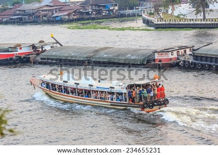 BANGKOK - AUG 2: Ferry boat in Chao Phraya River on Jan 31, 2014. The river is a major river in Thailand, with its low alluvial plain forming the centre of the country.