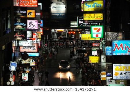 BANGKOK - AUG 17: Nighttime view of Soi Thaniya in Patpong entertainment district, known locally as Little Tokyo, famous for its Japanese oriented nightlife on Aug 17, 2013 in Bangkok, Thailand.  - stock photo