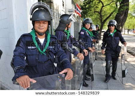BANGKOK - AUG 1: Police on standby at Government House as the government invokes martial law amid threats to national security and planned anti-government rallies on Aug 1, 2013 in Bangkok, Thailand.
